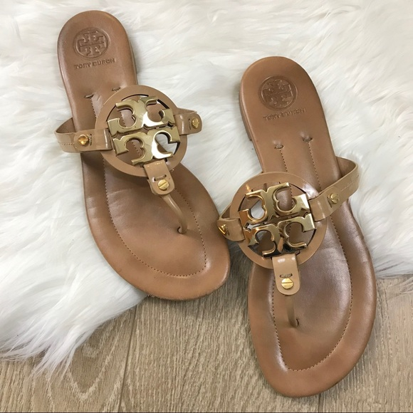 2316e84963e Tory Burch Brown Miller Gold Emblem Sandals. M_59f8031713302a71c90e4a8c
