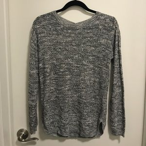 Grey knit w/angel wing detail. Like new!
