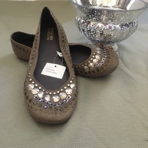 Flats with silver embellishments