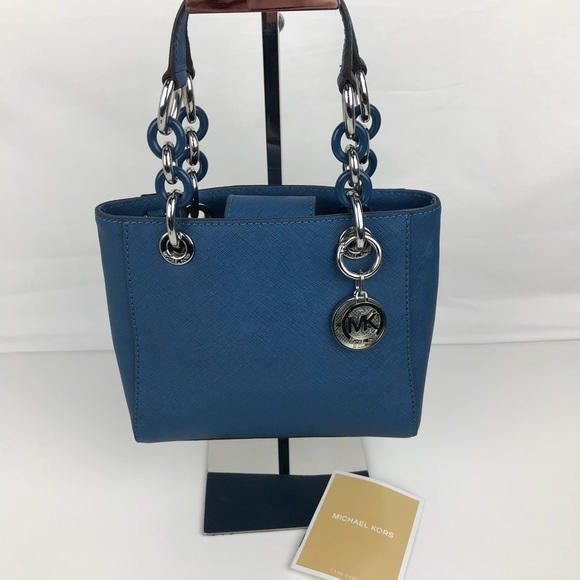 52f3fb7650a90 Michael Kors Cynthia Small North South Satchel. M 59f9014ca88e7d739602a499