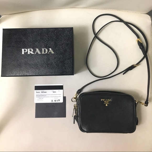 d94b24423ae4 PRADA Saffiano Leather Mini Crossbody Bag Black. M_59f9a444d14d7b4b13047ed6