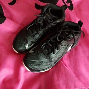 Black Nike kids basketball sneakers