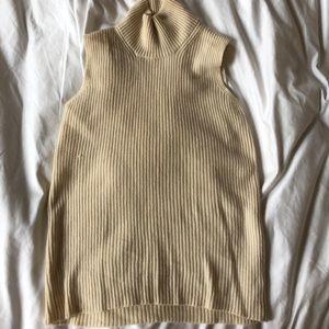 Sleeveless 100% cashmere mock neck