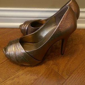 7ce66c36165 Coach and Four Bronze Heels Size 8