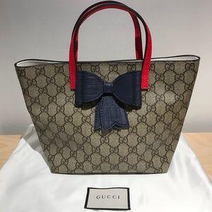 c18eba2529d Gucci Bags - Authentic Gucci Children s GG Supreme Bow Tote