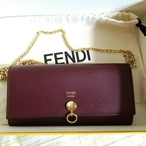 Fendi burgundy with gold chain on wallet