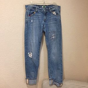 Anthropologie distressed embroidered patch jeans