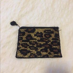 Glass sequined clutch in leopard print