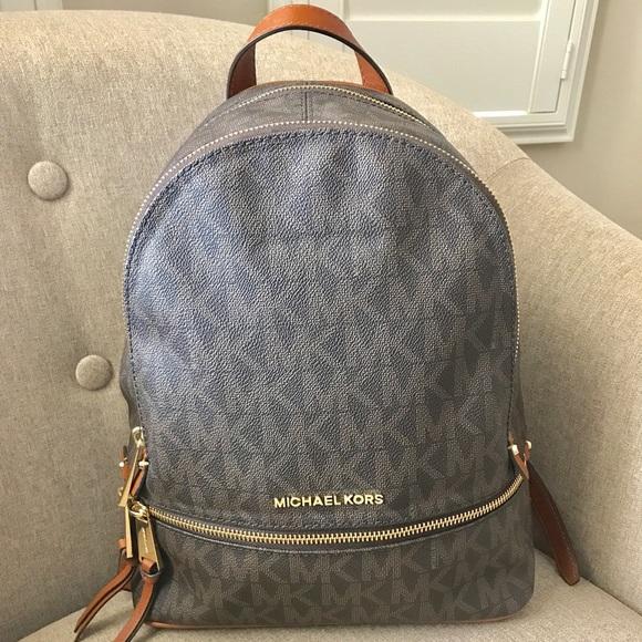 24058e8f9982 Michael Kors Brown PVC Rhea Zip Medium Backpack. M_59fd459bbf6df577f50701fe