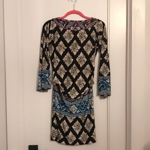 Muse bell-sleeved dress.