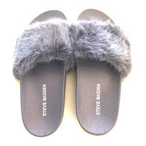 Grey Steve Madden slides with fur