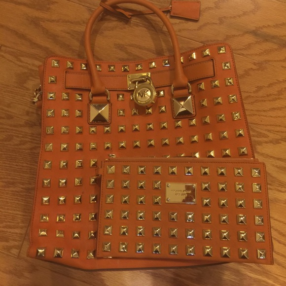 eab6ee8ea283c7 Tangerine Michael Kors studded Hamilton and Wallet.  M_59fe2a298f0fc4f75109b2f7. Other Bags ...