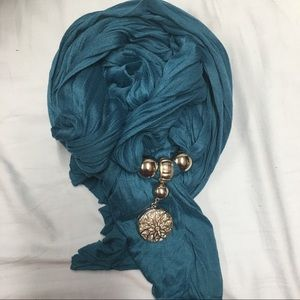 Teal scarf with metal accents