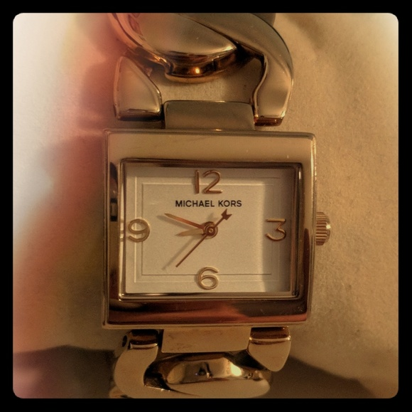 09d0fa7ec2a7 Michael Kors all stainless steel gold-tone watch. M 59fe7de1a88e7d16630b7049