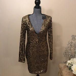 Dresses & Skirts - Long sleeves deep v gold sequin dress.