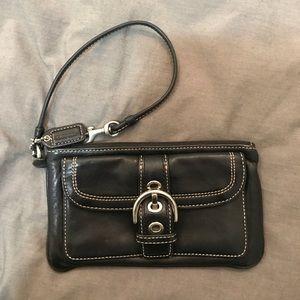 Coach wristlet, black leather.