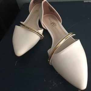 Pointed white ballet flats