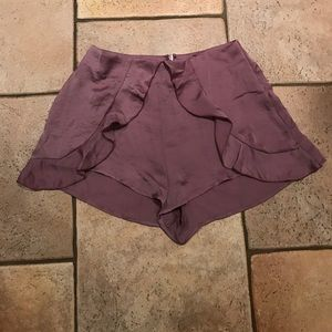 Light purple silky shorts with ruffles.