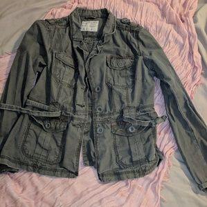 Grey distressed jacket.