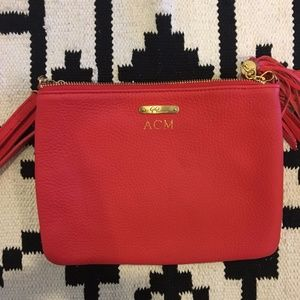 Gigi New York intial hot pink tassel clutch