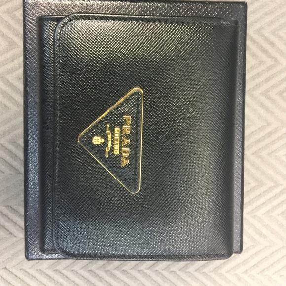 d5cb49b28439 Prada Saffiano Triangle leather wallet in black. M_5a00d94f522b453b0913eceb