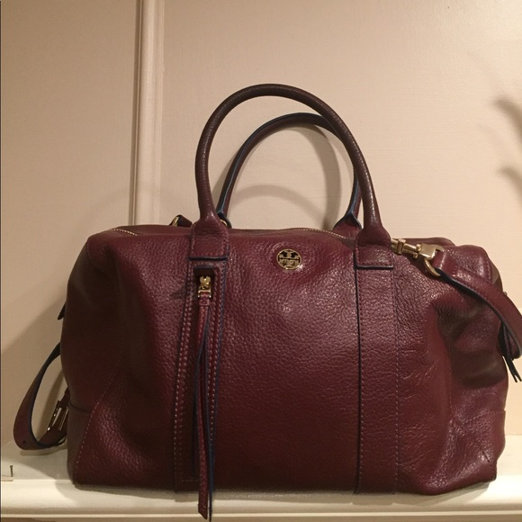 b3cbd61d794 Tory Burch Berry Oxblood Mini Leather Duffle Bag. M 5a012631eaf0301f970017a5