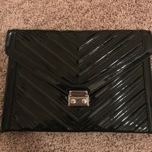 Shiny clutch. Great to dress up any outfit