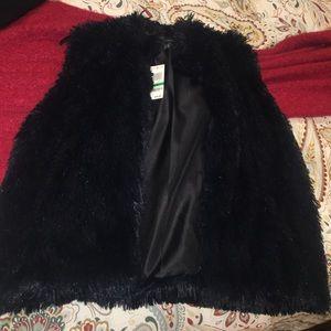 Faux fur vest BNWT inc international concept .