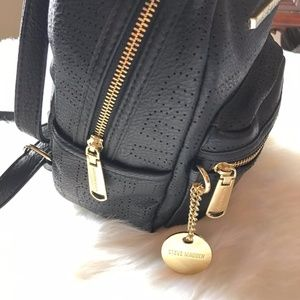 36b690b45bbd Steve Madden Bags - Steve Madden Bailey Mini Black and Gold Backpack