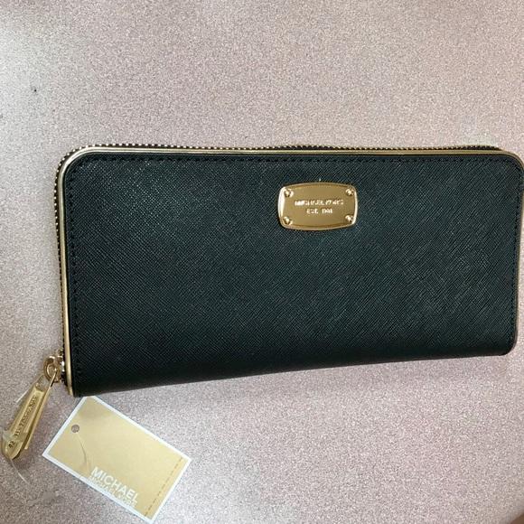 54a5a630c657 Michael Kors Saffiano Frame Continental Wallet -