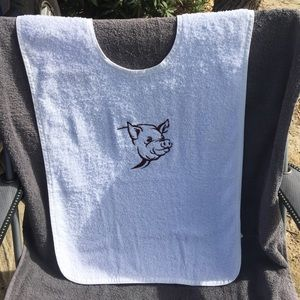Adult size bib, embroidered pig head.