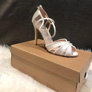 a5a6163f412 True decadence ivory strappy bow heeled NWT