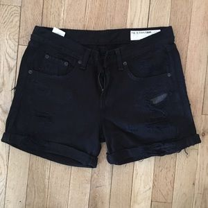 Ripped black denim shorts.