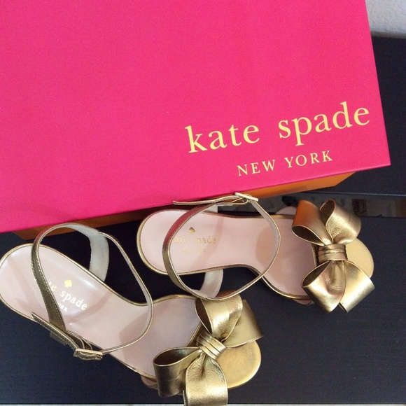 40b9f9595284 Kate Spade New York Iballa Gold Bow Wedge Heels. Listing Price   150