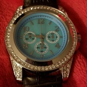 Women's watch with crystals around