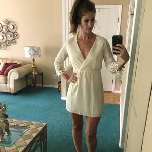Off white dress with lace at bottom of sleeves