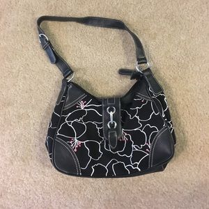 Black purse with white and pink floral.