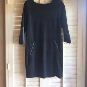 Women's Black Dress with faux leather trim.