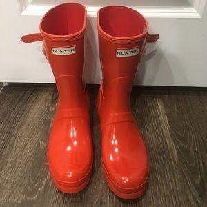 Short orange hunter boots