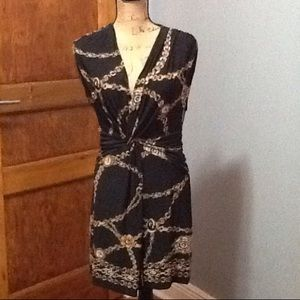 Cache black and gold chain print dress.