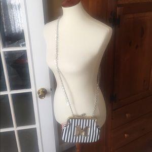 Melie Bianco KISS clutch or crossbody bag.