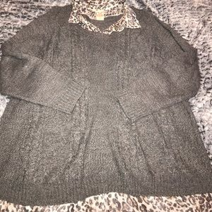 Sweater with collared shirt attached.