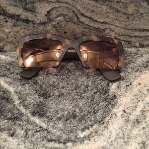Miu Miu Cutoff tortoise shell sunglasses
