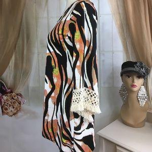 Sunny Leigh Tops - Sunny Leigh Animal Print Asymmetrical Boho Blouse