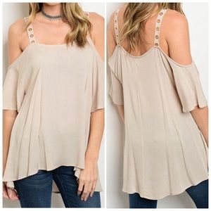 Nude cold shoulder tunic top with grommet detail.