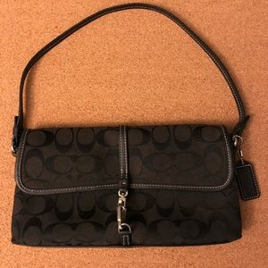 Coach black on black flapover baguette. Almost new