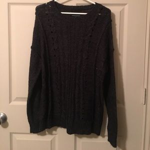 Grey sweater with detail in knit