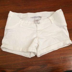 White denim maternity shorts.