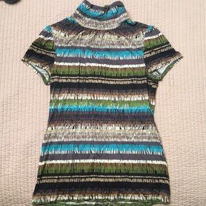 100% silk Trina Turk turtleneck blouse