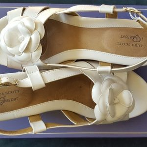 White wedge sandals with a flower by Laura Scott